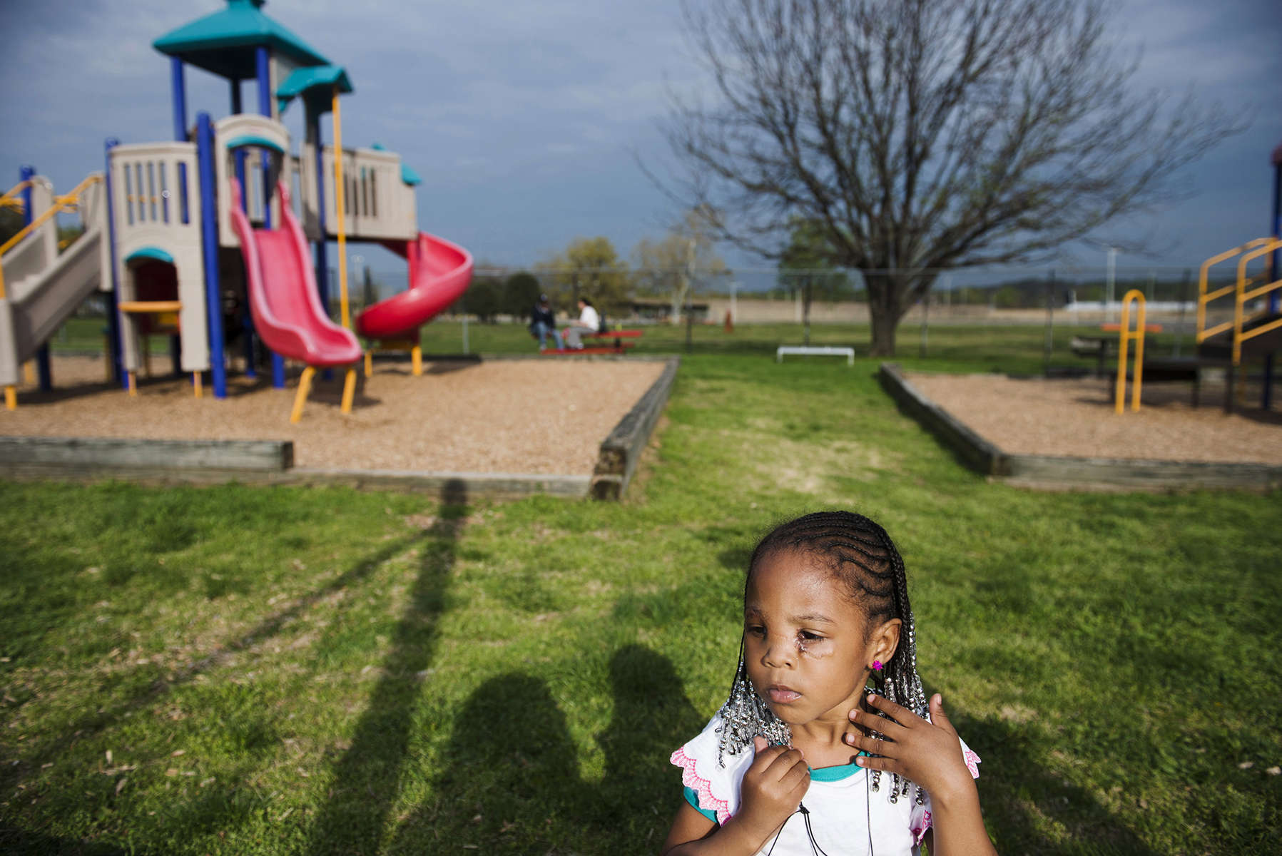 WASHINGTON, DC - APRIL 22: Kodie {quote}KoKo{quote} Brown plays  at the local playground near RFK stadium on Tuesday, April 22, 2014 in Washington, DC. {quote}For me, it's all about family right now. That's my main focus,{quote} said Ferguson, a DC police officer, who with his wife adopted {quote}KoKo{quote} after their daughter was fatally shot on a DC Metro Bus while trying to run from her boyfriend. {quote}KoKo{quote} was also seriously injured during the incident, suffering a gunshot wound to the face.   (Photo by Amanda Voisard/For the Washington Post)