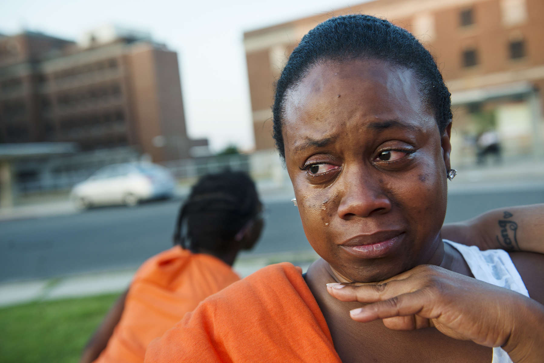 WASHINGTON, DC - JUNE 3: Bre Archie, 35, a resident of the DC General shelter of a year and four months comes to tears while attending the {quote}Rally of Respect{quote}  outside of the facility on Tuesday, June 3, 2014 in Washington, DC.   Residents and advocates outside the shelter came together to shine a light on the unhealthy conditions and safety concerns, including the disappearance of Relisha Rudd at the facility. Archie said she was frustrated with the shelter policies stating, {quote}Whenever I try to take two steps forward they are pulling me backward.  I am trying to go to school and they won't let my boyfriend come into the shelter to stay to watch my kids.{quote}  She added, There is no affordable housing in DC. If they close this building tomorrow, where is all these people going to go?{quote}    (Photo by Amanda Voisard/For the Washington Post)
