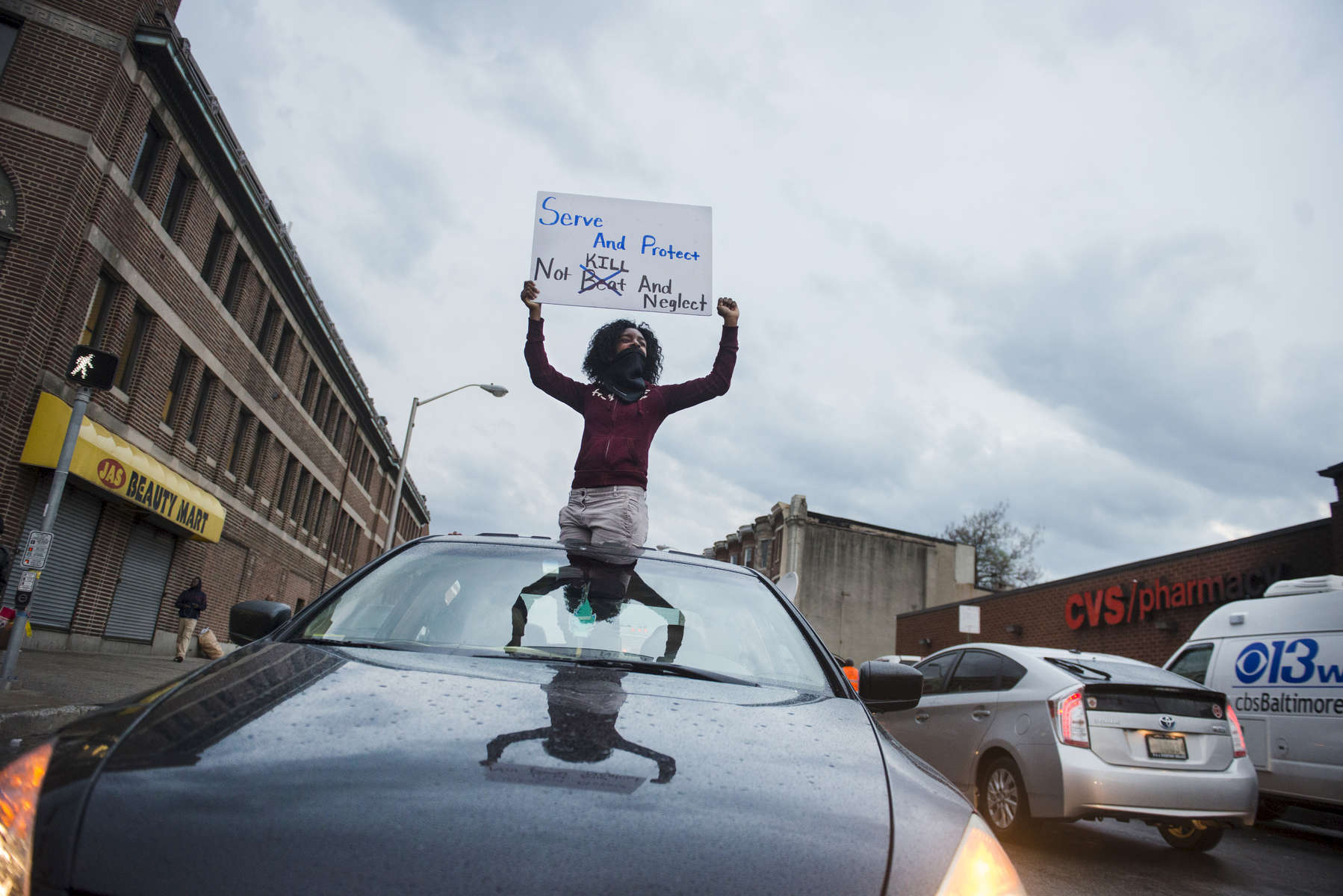 BALTIMORE, MD- APRIL 30:  Tajah Marshall, 17, supports protesters from her mothers car near the corner of North Ave and Pennsylvania Ave. on Thursday, April 30, 2015 in Baltimore, MD. (Photo by Amanda Voisard/For the Washington Post)