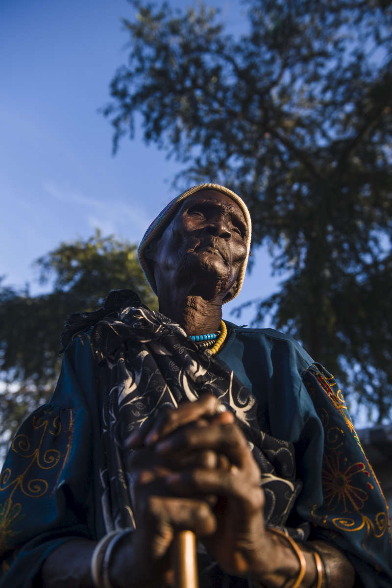Thief Luak, 80, originally of Bentiu, recently took up residency in the Protection of Civilians Site adjacent to the United Nations Mission in South Sudan.  Luak, who is seen on Tuesday, 31 Oct. in Bor, South Sudan said she made the long journey due to food insecurity.
