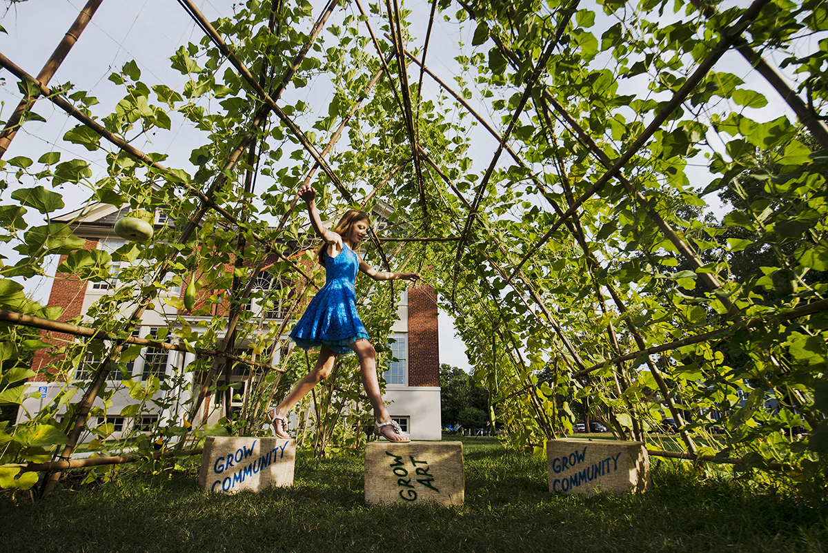 Amanda Voisard/For The Washington Post - Chloe Fugle, 12, stands inside the Gourd Palace Spirit House, a living sculpture at the Arlington Arts Center. The sculpture was inspired by Chloe's winning model she made at school.