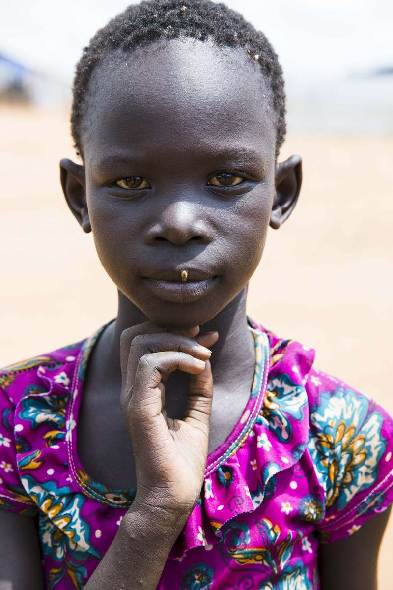 A young girl is seen in the Protection of Civilians 3 camp outside the UN House United Nations Mission in South Sudan compound on Saturday, 17 June, 2017 in South Sudan.