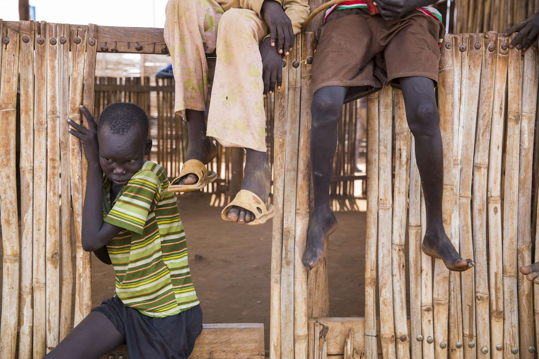 Young boys play in the Protection of Civilians 3 camp outside the UN House United Nations Mission in South Sudan compound on Saturday, 17 June, 2017 in South Sudan.