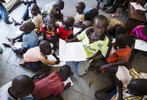 Unaccompanied minors, who fled the civil war in South Sudan, draw pictures while they wait for a visit from the United Nations Secretary-General Antonio Guterres at the Imvepi refugee camp reception center in Northern Uganda on 22 June, 2017.   UNHCR reports that 59 percent of those arriving in the camps are children under the age of 18 years.
