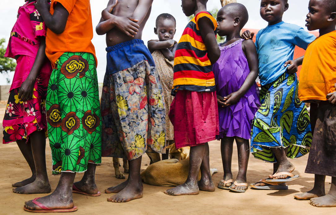 Young children wait to be processed at the Busia collection point near the Uganda/South Sudan border before their final destination of the Impvepi Refugee Camp on Friday, 23 June, 2017 in Busia, Uganda.  The refugee crisis in East Africa his reached historic levels with Uganda hosting now more than 1.2 million refugees.  UNHCR reports that 59 percent of those arriving in the camps are children under the age of 18 years.