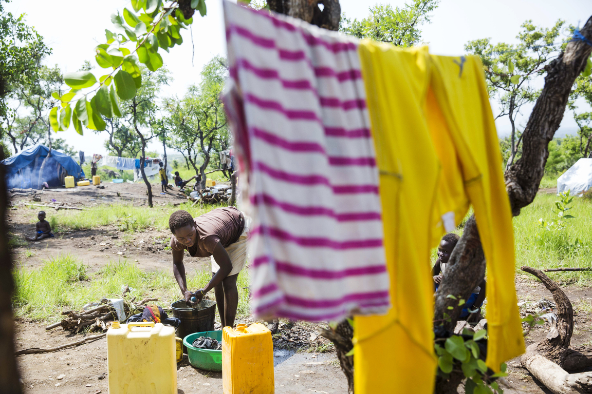 Gladys Joy does washing for her family of six while at the Imvepi Refugee camp in Northern Uganda on Saturday, 24 June, 2017.  The refugee crisis in East Africa his reached historic levels with Uganda hosting now more than 1.2 million refugees.  Gladys' family fled their home in Yei, South Sudan after a surge in violence in March.  Many of the new arrivals are from the Yei River State, know to be an ethnically diverse area and the breadbasket of South Sudan.  An UNMISS Human rights reports states that the region experienced an outbreak of ethnically motivated violence in July of 2016, displacing 70 percent of the population, sending a ripple effect across communities.