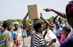 Refugees gather their monthly rations at a food distribution site in the Imvepi refugee camp in Northern Uganda on Saturday, 24 June, 2017.    Record numbers of South Sudanese have fled their home country crossing the border into Uganda, a country now hosting now more than 1.2 million refugees.   Food shortages continue to be an issue in the camp due to the humanitarian response struggling to meet the overwhelming needs of the refugees.
