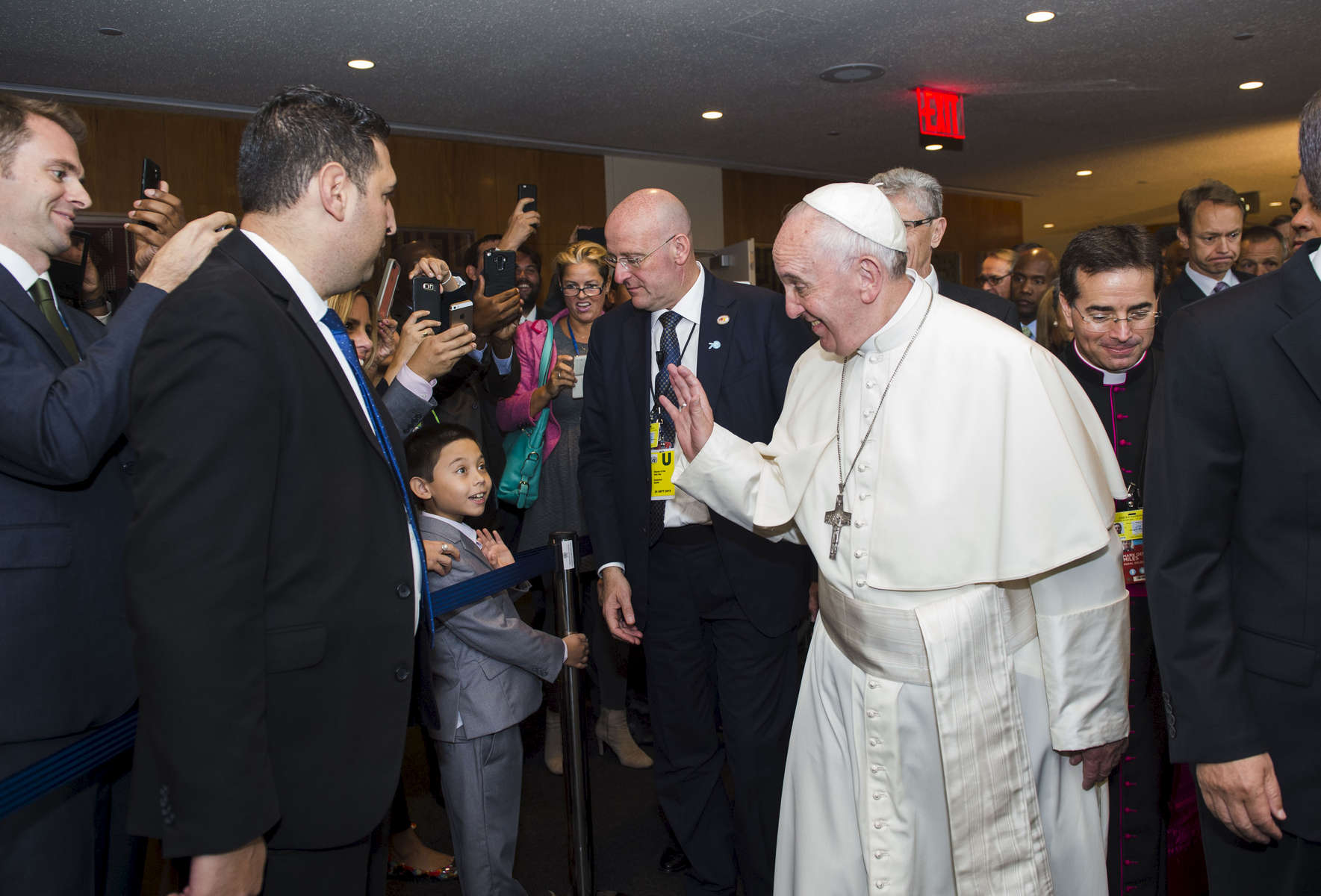 Pope Francis waves to Keanu Usamanont, 7, son of UN employee Jennifer Longo during his exit from the United Nations Headquarters