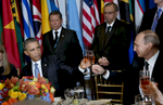 United States President Barack Obama, left, and Vladimir V. Putin, right, President of the Russian Federation, share a toast at a luncheon hosted by Secretary-General Ban Ki-moon in honour of world leaders attending the general debate of the General Assembly.