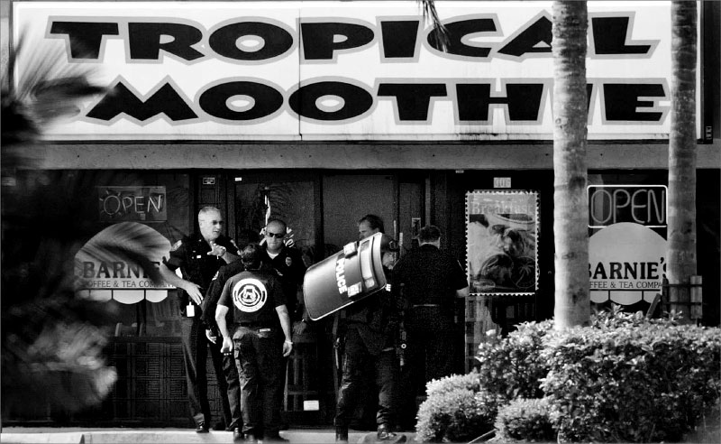 Police investigate the scene of a murder suicide after discovering the bodies of Brittany Carleo, 17, and Scott David Uslan on Saturday morning at the Tropical Smoothie Cafe on Port St. Lucie Blvd.