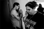 Frank Carleo, overcome with grief in the days following the murder of his daughter Brittany Carleo leans against the wall of his home while his ex-fiance Jo Ann Bauer uses the phone.