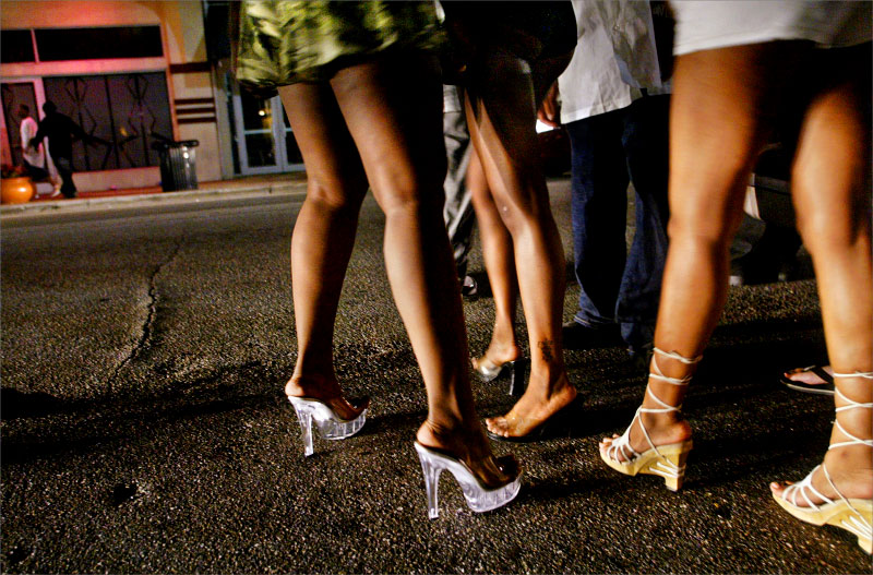 Tara Zanders, admitted not real name, Erica Bivins, middle, and LaWanda (no Further name given), right, depart Clematis street Saturday night as clubs close their doors for the evening.photo by: Amanda Voisard