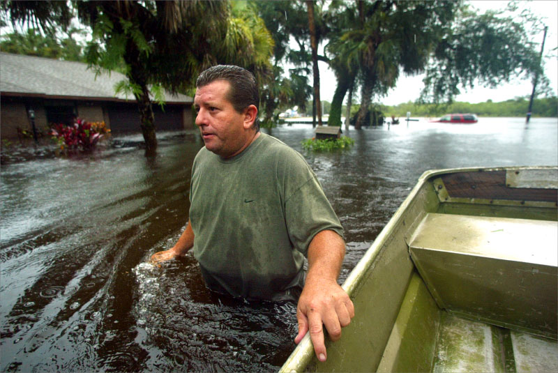 Tony Tescher, pulls a boat to friend Shad Slades home at 3606 Wilderness Dr. to collect food from the home.  Slades home was badly damaged from flood waters and the pair planned to take the food to his grandmothers dry home in the neighboring community.photo by: Amanda Voisard