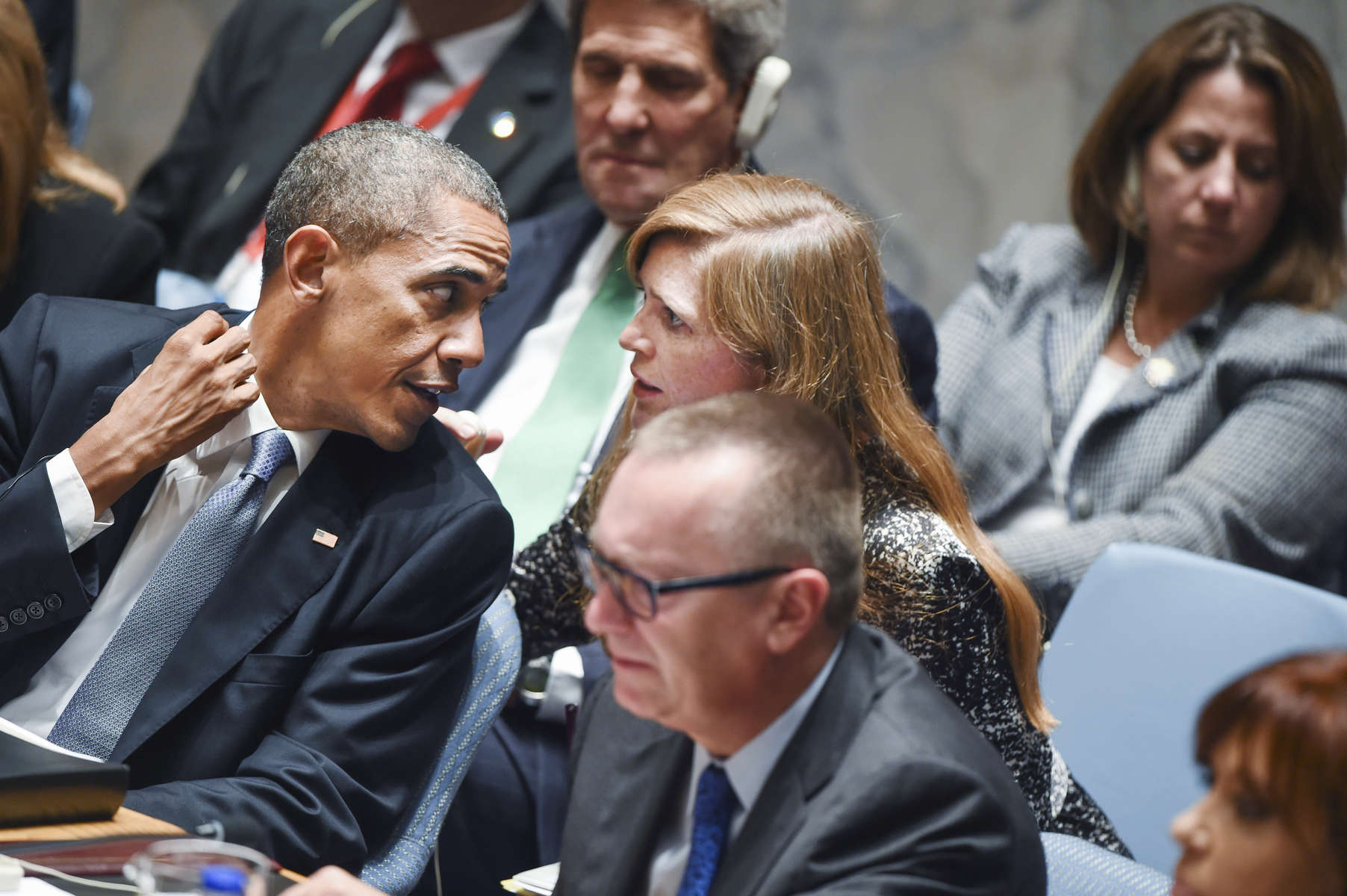 President Barak Obama leans over to chat with United States U.N. Ambassador Samantha Power, while sitting in as President of the UN Security Council at the United Nations Headquarters in New York City.