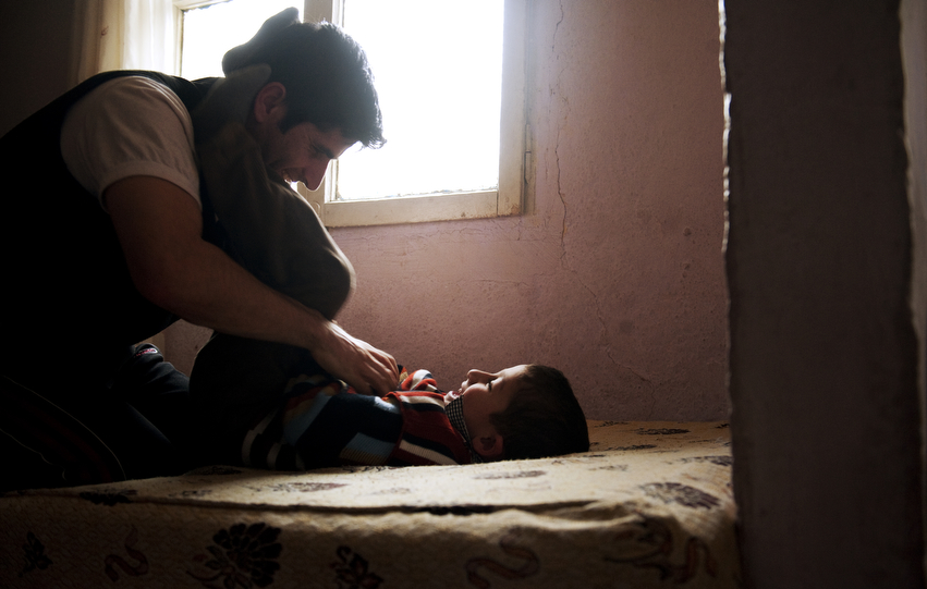 Irfan Kesman tickles his son, Firat, 5, during an afternoon off work, at his home in Besiktas, Istanbul.