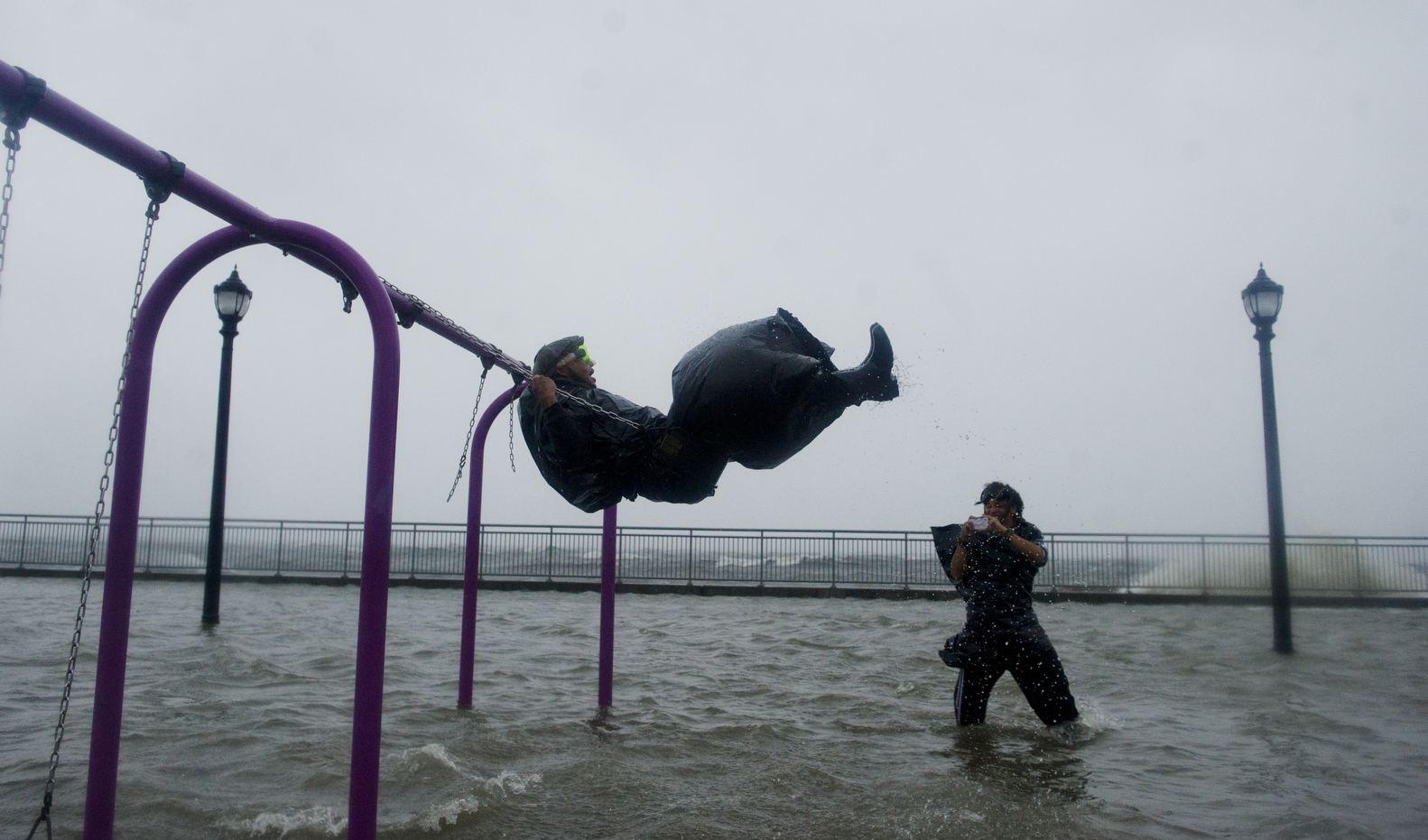 A group gathers in a flooded park as Hurricane Sandy makes landfall.