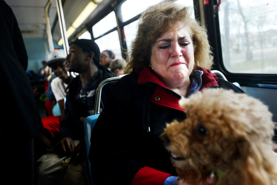 Victims of Hurricane Sandy are bussed out of Long Beach, NY.