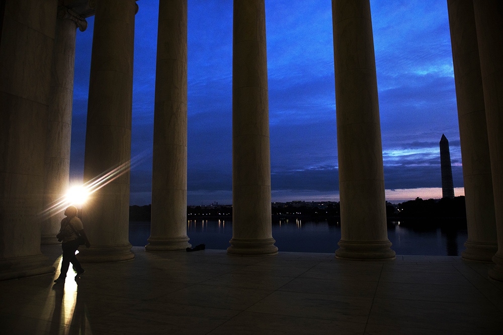 WASHINGTON, DC - JUNE 23: Sidney Presley walks through the Jefferson Monument at  daybreak, in an attempt to  catch a glimpse of the {quote}super moon,{quote} on Sunday, June, 23, 2013 in Washington DC.  The {quote}super moon,{quote}  is the biggest and brightest moon of the year due to its close proximity to the Earth.   Presley drove to the monument with her mother and friend from Fort Washington to see the moon but were prevented from their goal due to heavy cloud cover which concealed the moon from viewing.   {quote}It was in absence,{quote} said Presley's mother, Nancy Presley, not pictured, who had intended to photograph a panoramic photo for her Photoshop elements class.  (Photo by Amanda Voisard/For the Washington Post)