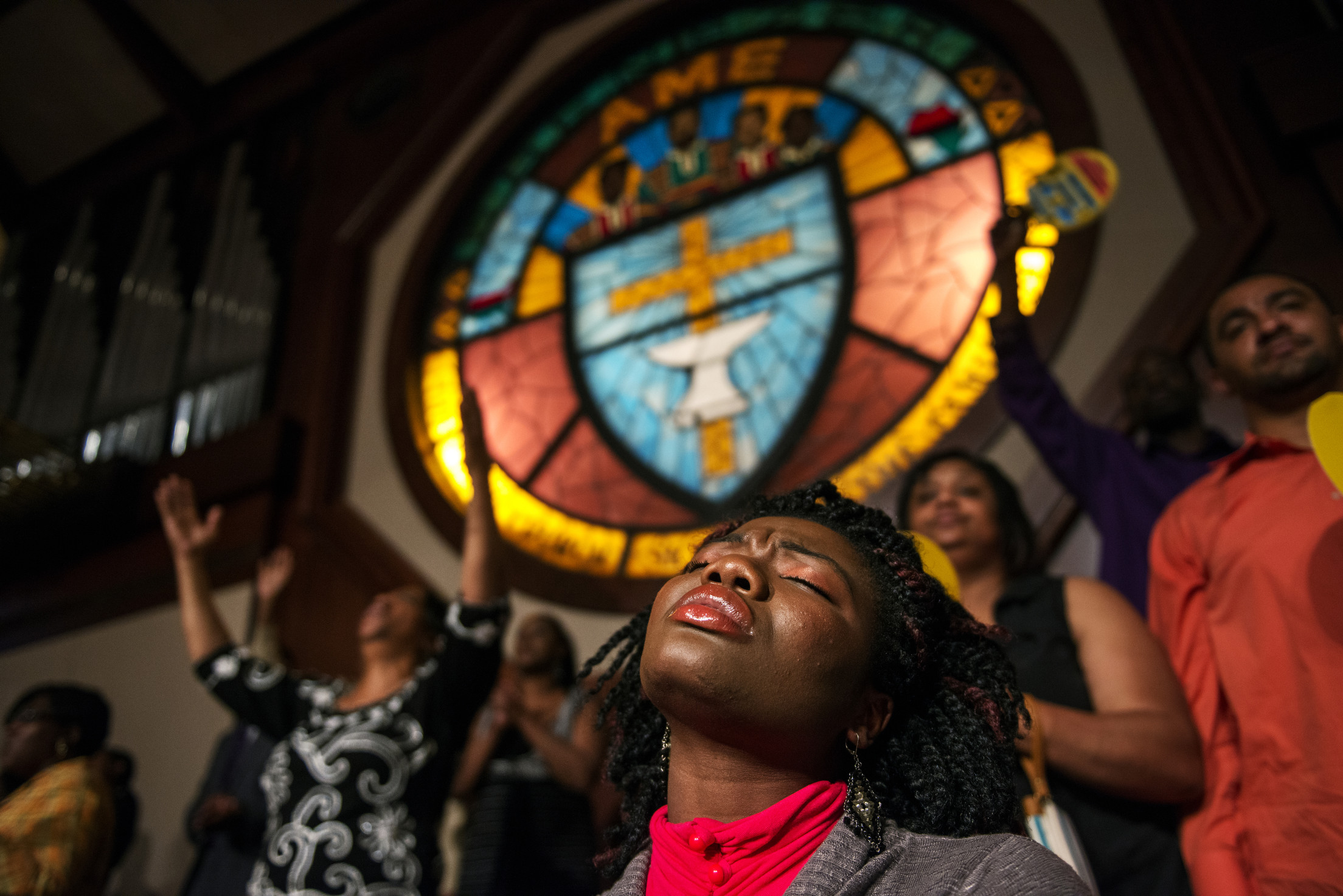 FORT WASHINGTON, MD - MAY 09:  Rachel D. Kamasse sings along as John P. Kee and New Life perform while attending the McDonalds Gospel Tour on Thursday evening at Ebenezer AME Church in Fort Washington, MD. (Photo by Amanda Voisard/For the Washington Post)
