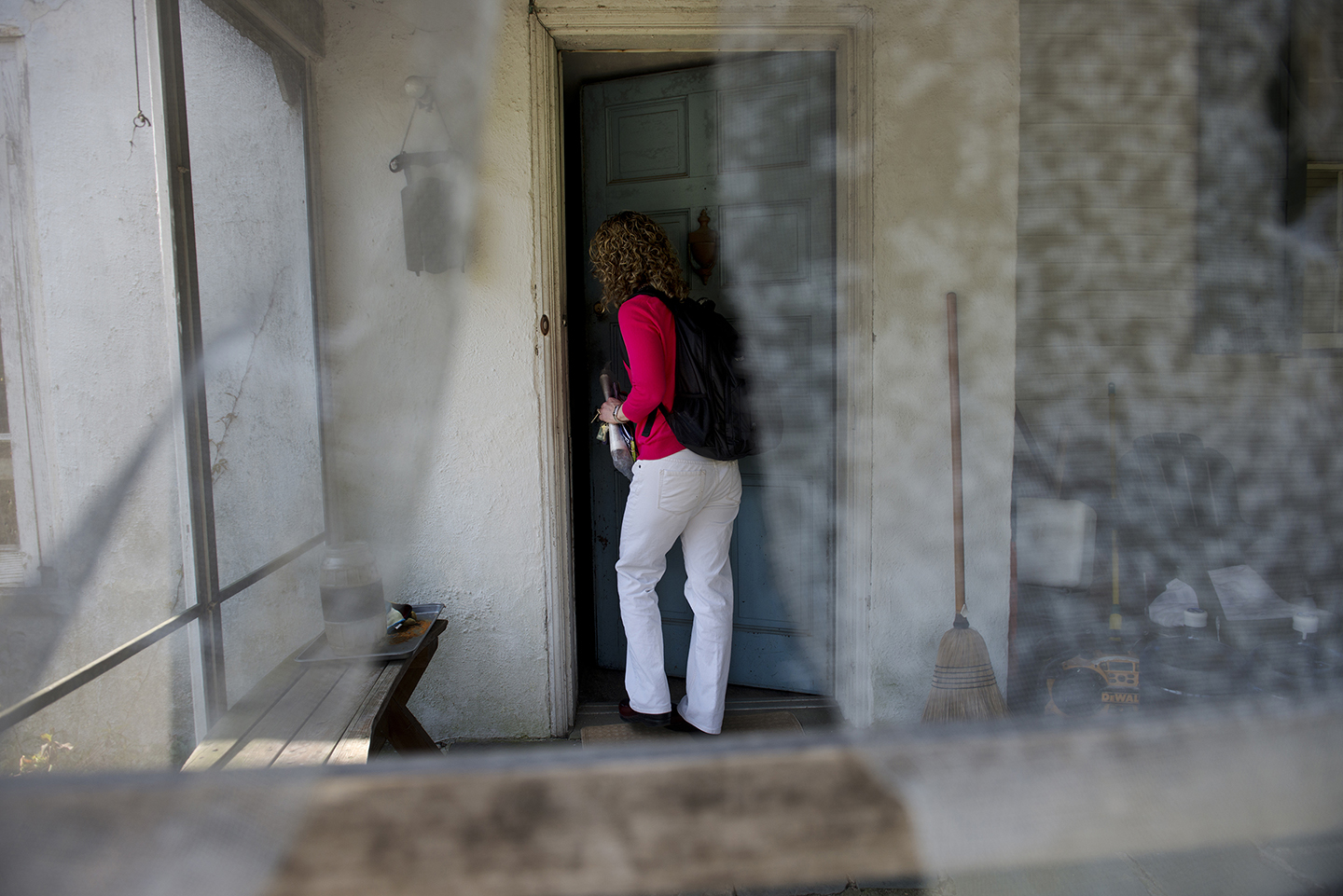DOYLESTOWN, PA - APRIL 24:  Patty Graefe, Clinical Team Leader at Health Quality Partners research and development organization, enters the home of Paul and Betty Bradfield during her weekly visit to the home outside of Doylestown, PA on Wednesday.   (Photo by Amanda Voisard/For the Washington Post)
