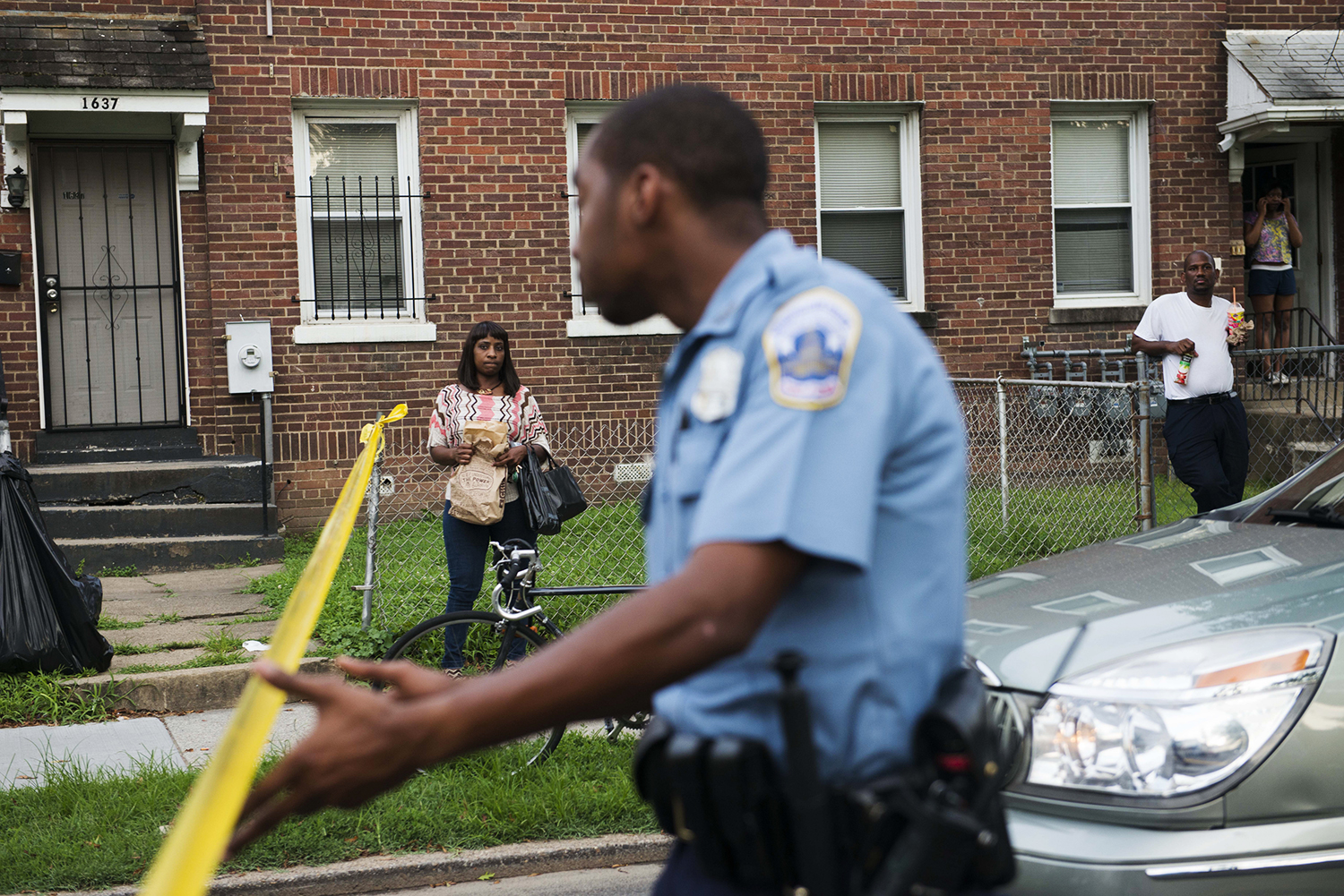 WASHINGTON, DC - JULY 8:  Neighbors linger near the scene of where  7 year-old son, Michael Kingsbury's body was, was found on Monday July 8, 2013 in Washington, D.C.  The young boy was found after several days of searching in a parked vehicle near the families home on the 1700 block of West Virginia ave NE.  (Photo by Amanda Voisard/For the Washington Post)