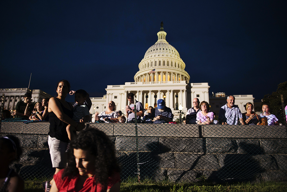 WASHINGTON, DC - JULY 3:  Groups gather on the lawn of the capitol during the rehearsal for the {quote}A Capitol Fourth{quote} -America's Independence Day Celebration{quote} on July 3, 2013 in Washington, DC. (Photo by Amanda Voisard/For the Washington Post)