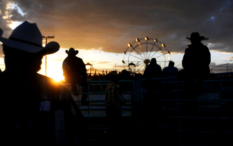 The sun sets on the 98th Annual Shiprock Navajo Fair in Shiprock, N.M as eager fans await the start of the Saturday evening rodeo. The Navajo Nation's largest traditional gathering began Thursday and ended Sunday.  Events included a rodeo, pow-wow, traditional song & dance, parade and carnival.