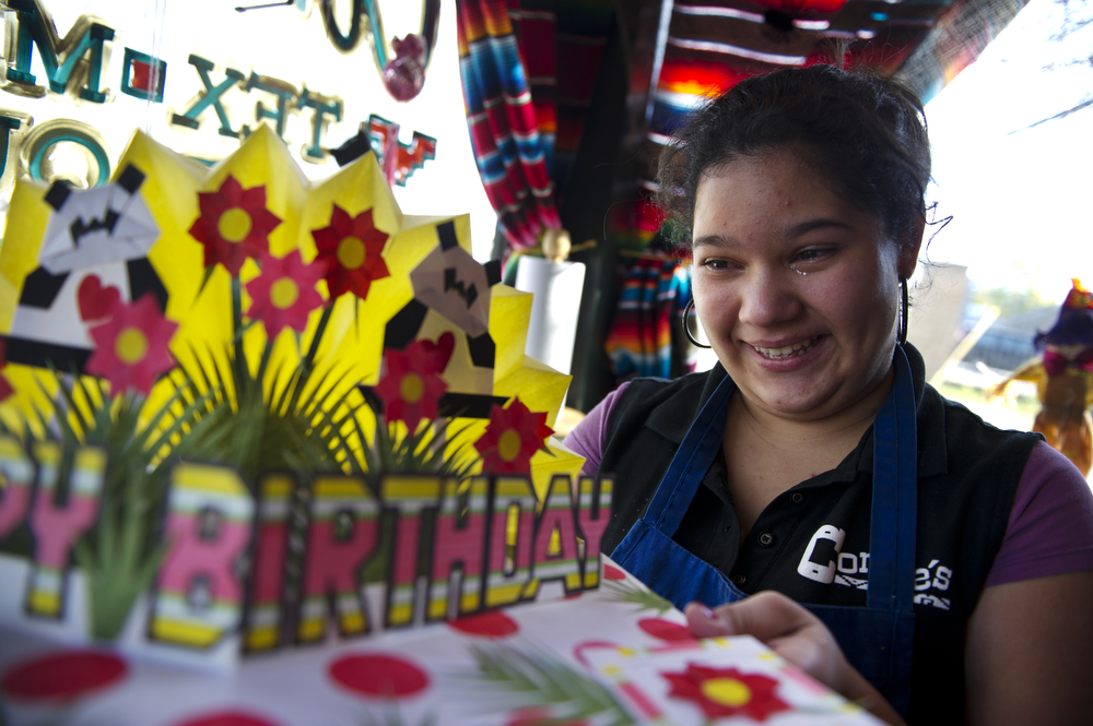 Daniela Velasquez, holds a fifteenth birthday card made in prison by her new step-father, Manuel Cruz.  Daniela's birthday is on Sunday Oct. 17, 2010.  In Columbia a young woman's fifteenth birthday is usually marked by the cultural tradition of the Quinceanera.  Daniela will have to wait a year before taking part in the tradition during a return trip to Columbia.