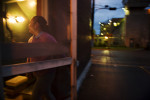 Silvia Cruz escapes the rain through the backdoor of Connie's cafe early Friday morning.