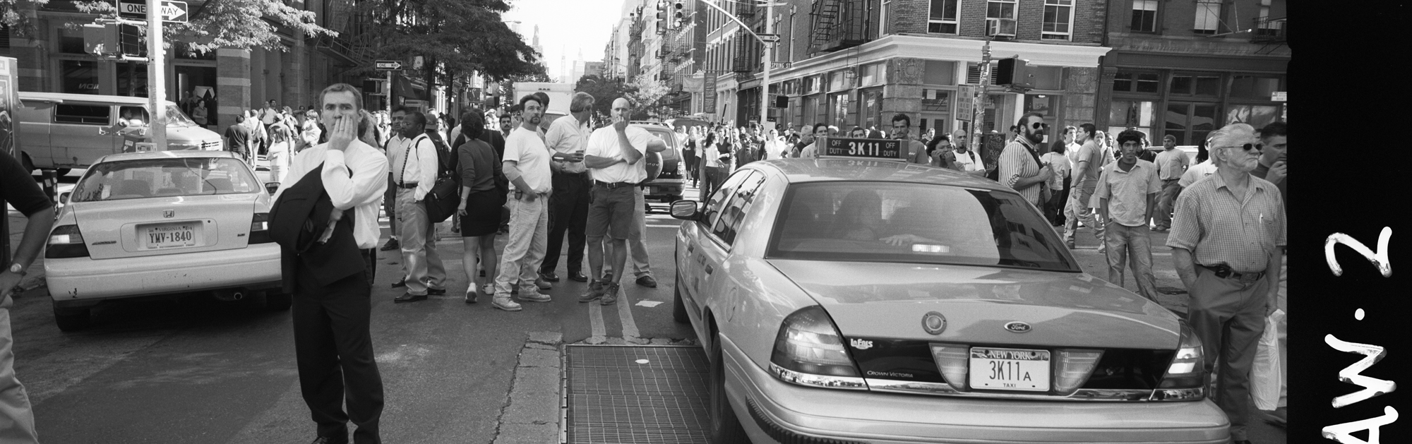 Moments after the  South tower, the first to colapse,  colapses at 9.59am. The 9/11 terrorists attacks in New York City part of a comlete edit of 100 photos. Soho, New York City, New York