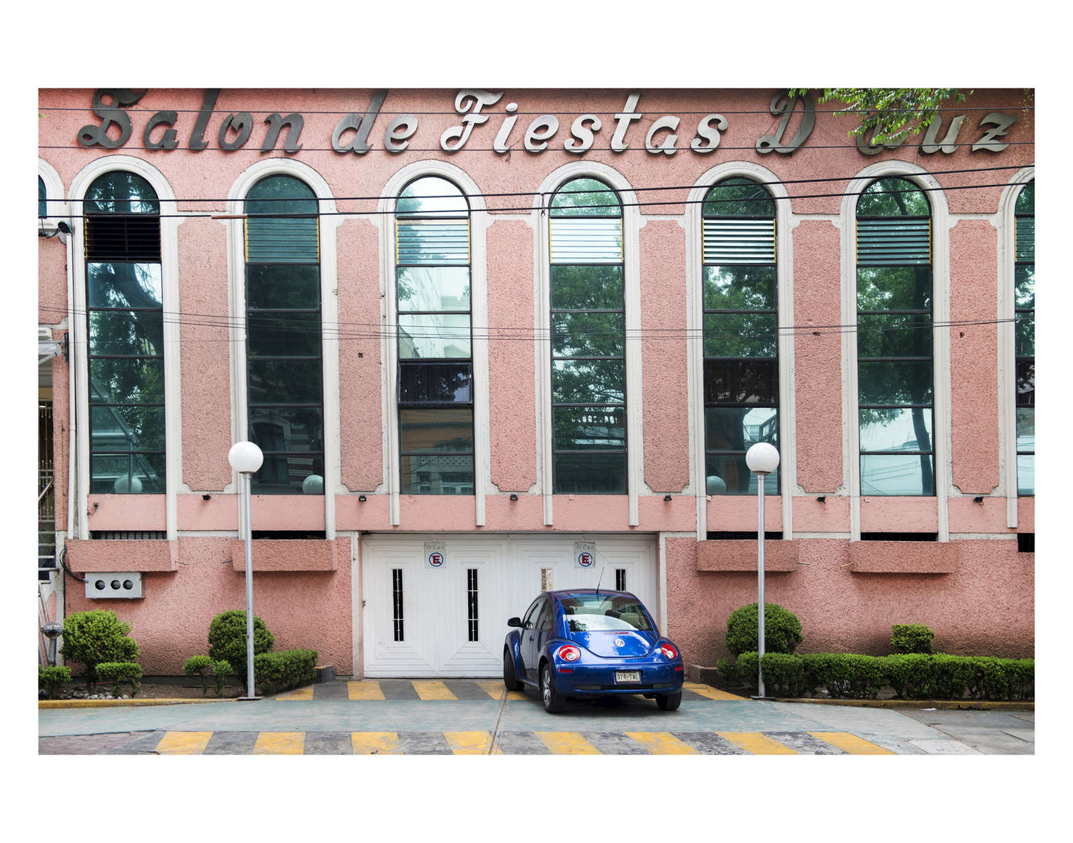 A beetle parked outside a Salon de Fiestas in the Roma neighborhood of Mexico City.