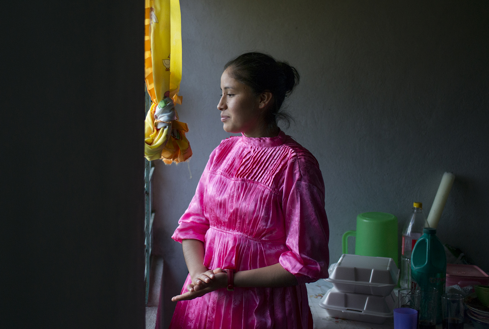 Portrait of Ana Karen Cruz Casiano 18 years old in the kitchen of her home in the Mazahua indigenous community near San Felipe del Progreso, in the Estado de mexico, Mexico