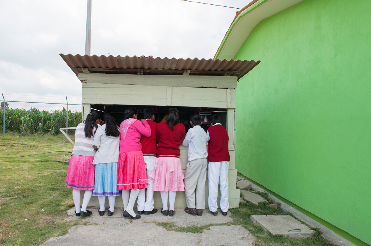 Children buy snacks at their school¥s tuk shop. Secondary school Justo Sierra in the  Mazahua indigenous community of San Antonio la Cienega, San Felipe del Progreso, in the Estado de mexico, Mexico