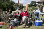 Portrait of D (John Wiseman) infron of the contents of his shed in the midst of cleaning and organizing his shed after 20 years. Visit to parents in  Thakeston, Somerset, UK