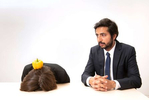 Laure Stockley and Hasan Waliany. Photoshoot for Obstacle, absurd corporate scenes at the Hassell offices, London, UK