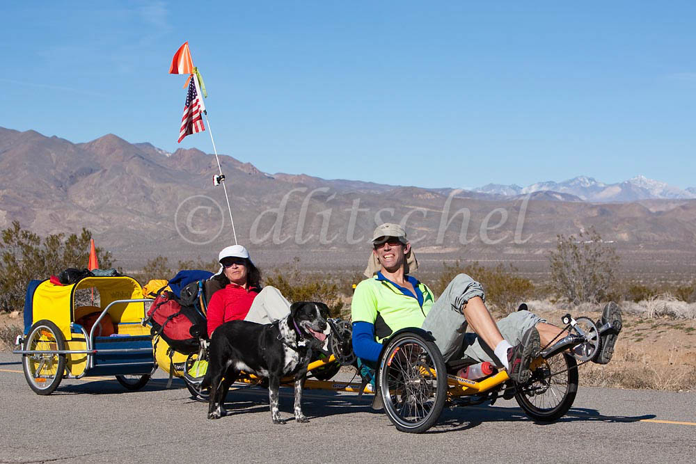Tandem recumbent bicycle riders on the Mojave Desert backroad leading to the {quote}living ghost town{quote} of Randsburg California. To purchase this image, please go to my stock agency.