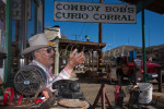 Cowboy Bob Keiser sits outside his Cowboy Bob's Curio Corral, an antique store, located in the {quote}living ghost town{quote} of Randsburg, California. To purchase this image, please go to my stock agency.