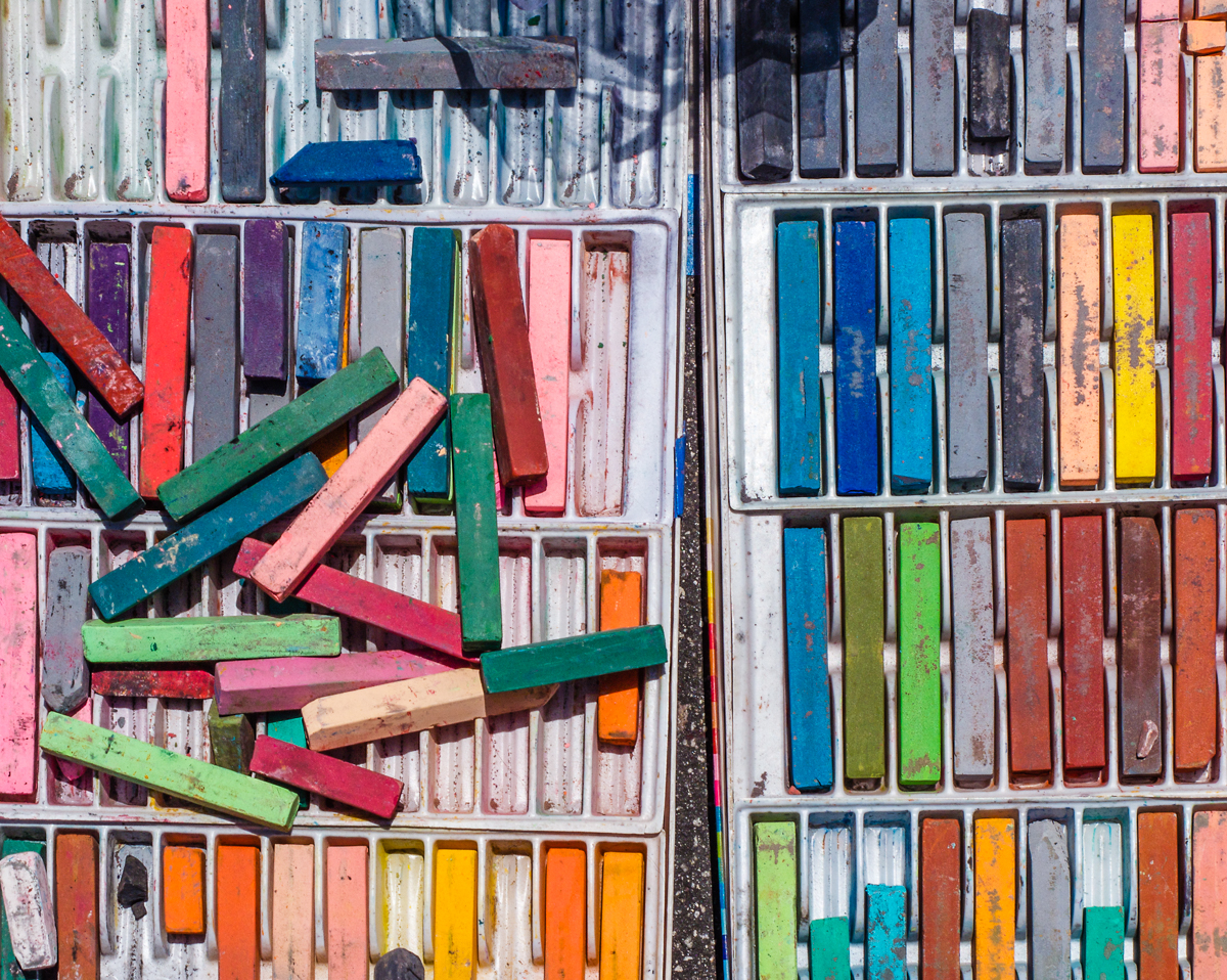 Detail of various types and colors of chalk lined up or stacked up in boxes for the annual Imadonnari festival of chalk painting at the Santa Barbara Mission in Santa Barbara, California.