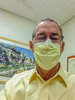 Selfie with medical mask in doctor's office
