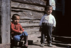 Two young Siberian boys in front of their log home in northern Siberia in the Krasnoyarsk Krai region.