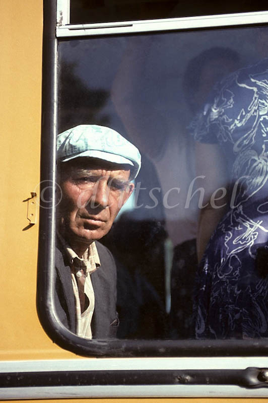 A Russian man peers out of a bus window in  Abakan, a city in southern Siberia, Russia. Abakan is located in the Krasnoyarsk Krai region of Siberia.