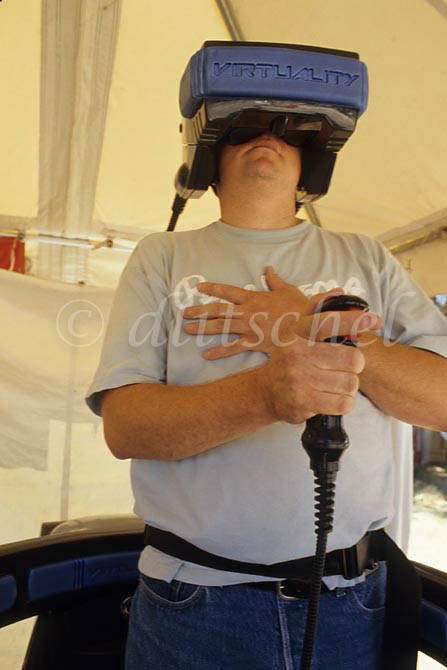An adult male tests out a very early version of a virtual reality device at a county fair in California. To purchase this image, please go to my stock agency.