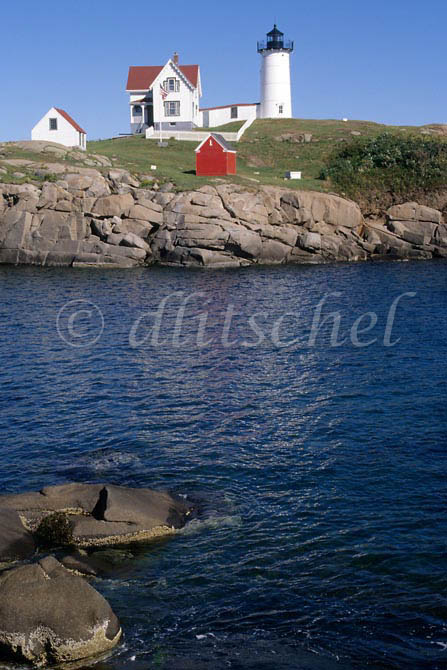 A picturesque view, across an inlet, of the Pemaquid Point Light House and the keepers house in Bristol, Maine, USA. To purchase this image, please go to my stock agency.