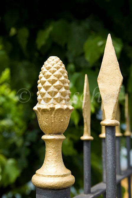 Fancy iron fence finials in Bellagio, Italy. To purchase this image, please go to my stock agency click here.