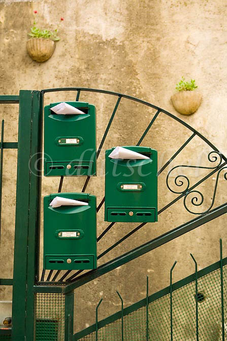 Green mailboxes form an interesting pattern in Brunate, Italy. To purchase this image, please go to my stock agency click here.