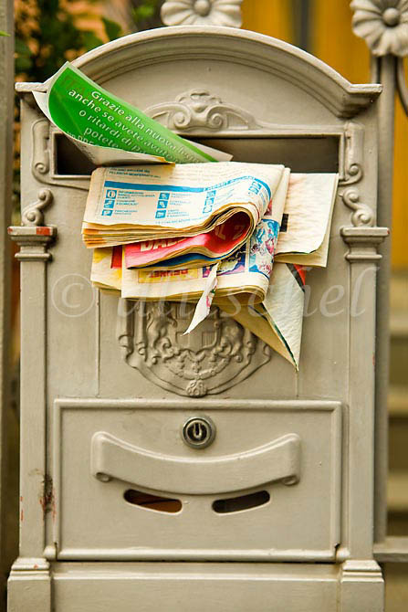 A mailbox in Brunate, Italy is overstuffed with mail. To purchase this image, please go to my stock agency click here.