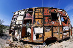 An extreme wide angle view of a desserted recreational vehicle that has lost its siding sits in a California desert. To purchase this image, please go to my stock agency click here.