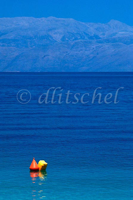 A deep blue ocean and sky with an orange and yellow buoy in the foreground in the Peloponnese located in the southern area of Greece. To purchase this image, please go to my stock agency click here.