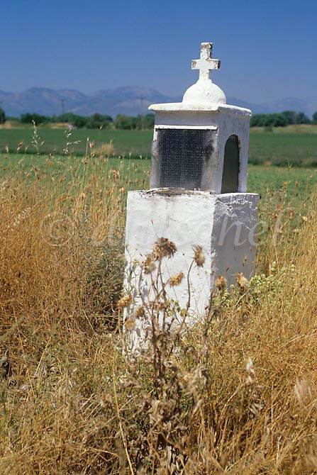 A roadside concrete religious shrine with cross in the Greek countryside. To purchase this image, please go to my stock agency click here.