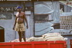 A dockworker with a large hook unloads cargo in the southern Indian city of  Chennai in the state of Tamil Nadu.To purchase this image, please go to my stock agency click here.